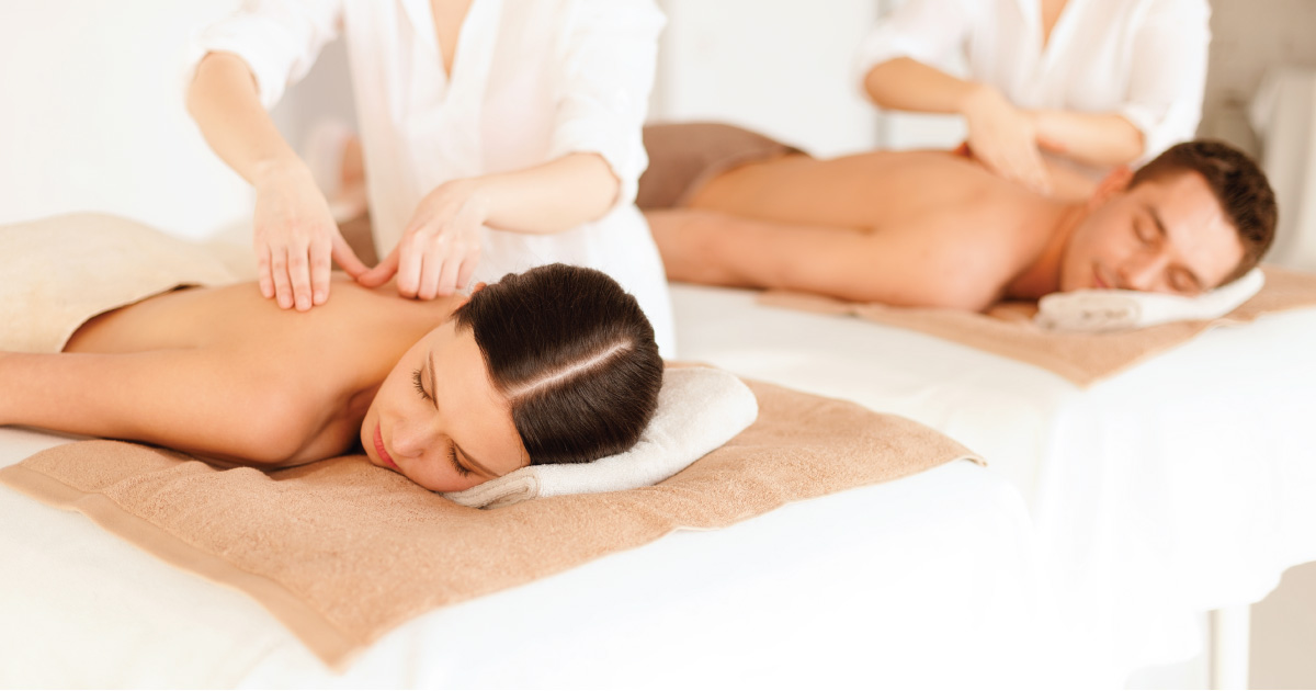 Man and woman receiving relaxation massage