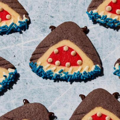 Cookies in the shape of a shark with mouth open